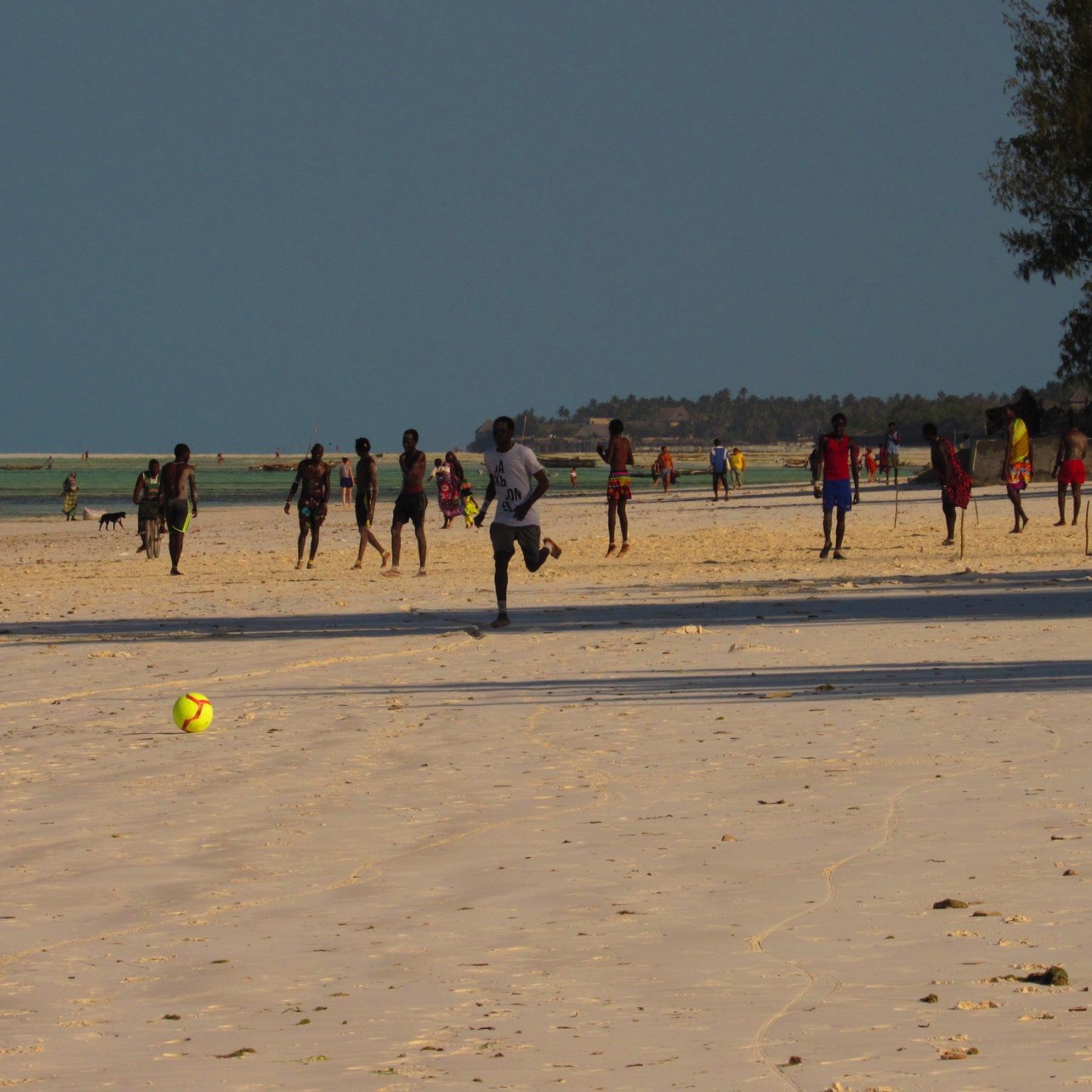 People playing football on Jambiani Beach, Zanzibar