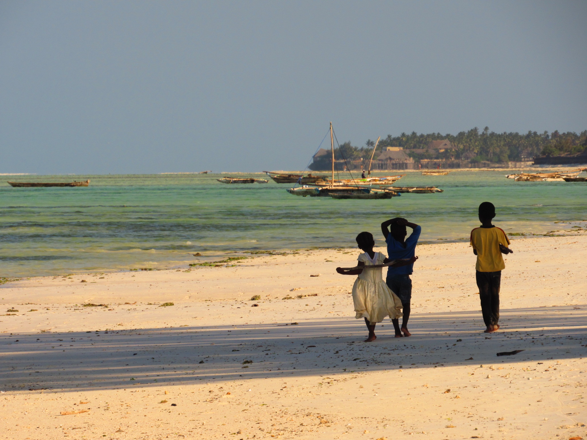Kids playing on Jambiani Beach in Zanzibar, Tanzania