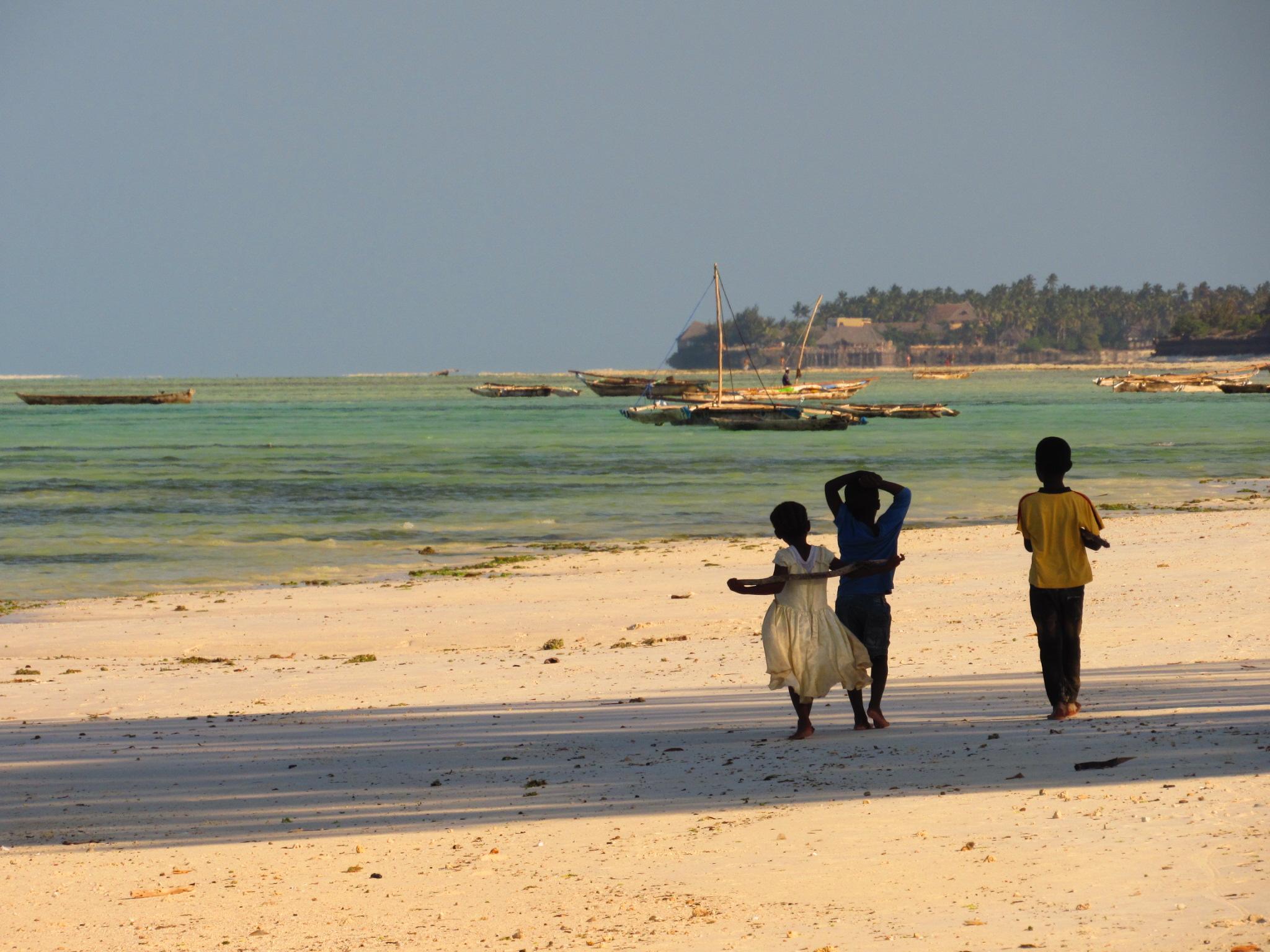 Kids playing on Jambiani Beach in Zanzibar, Tanzania