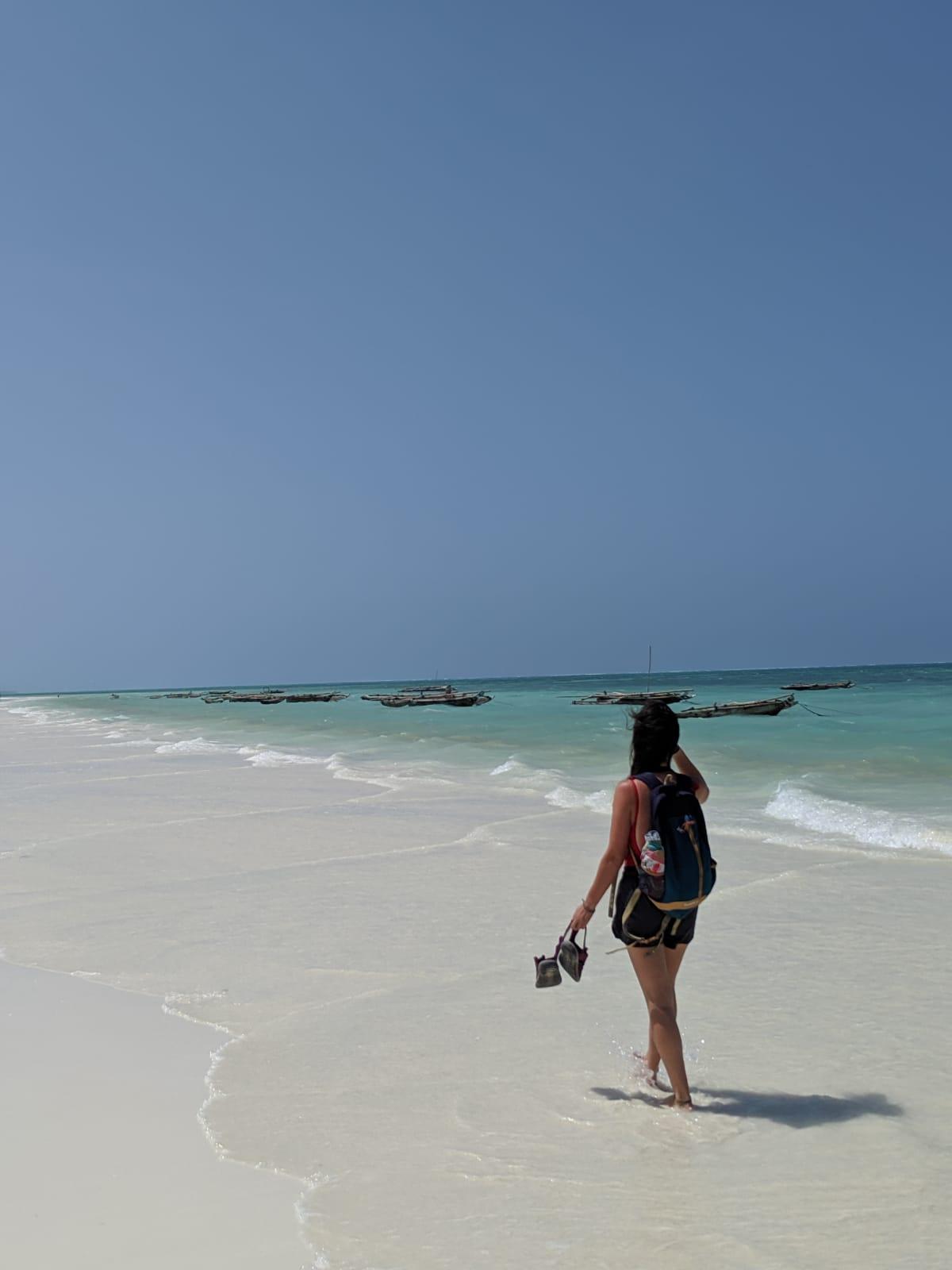 Walking on the white sand in Jambiani Beach, Zanzibar, Tanzania