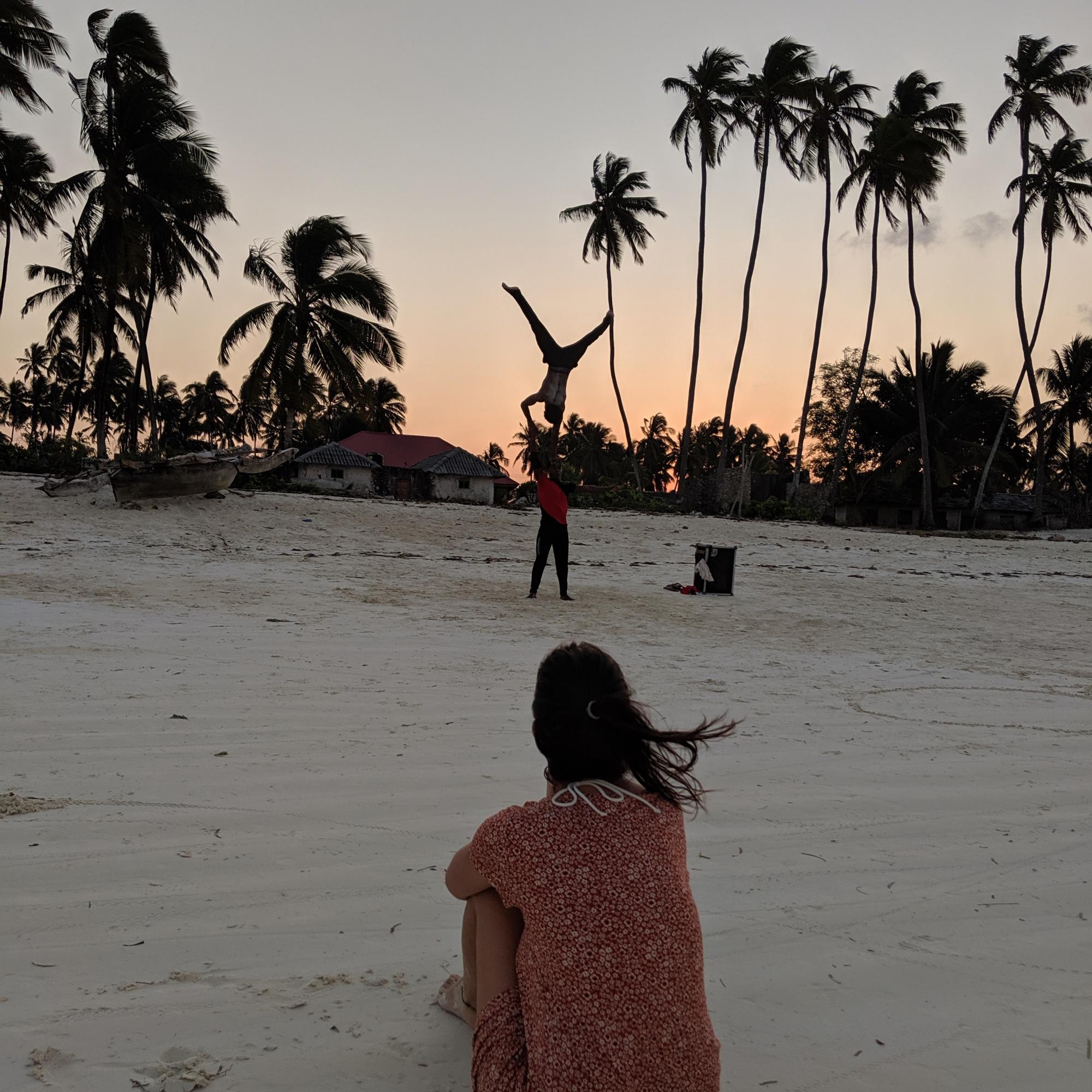 Watching people training an acrobatic routine at sunset on Jambiani Beach, Zanzibar