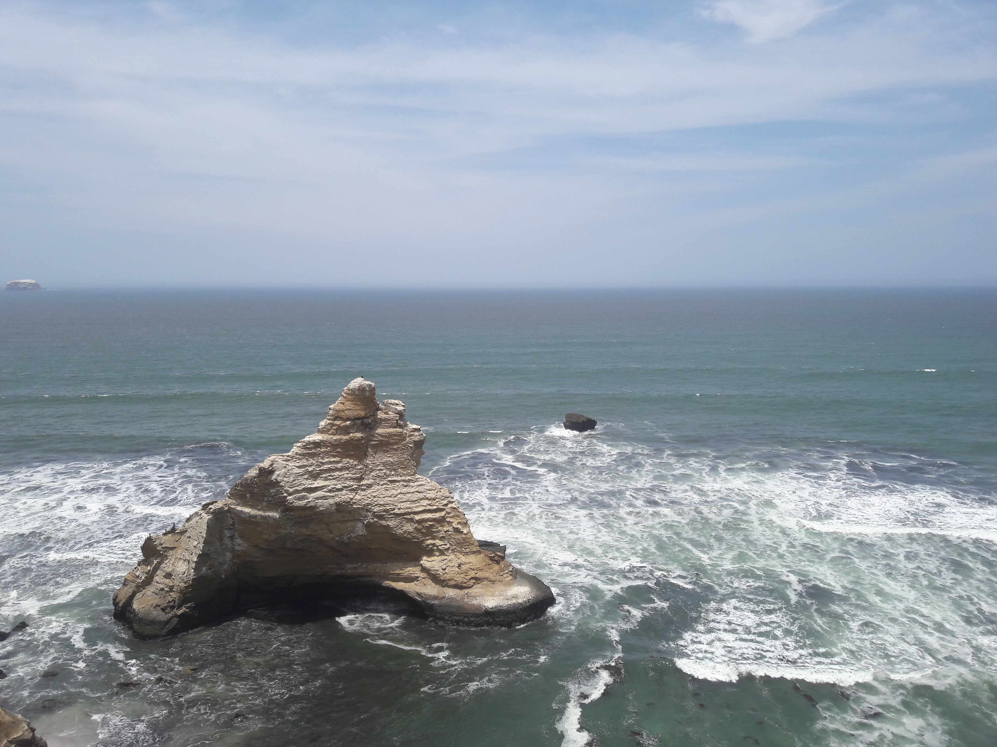 A rock formation in the water