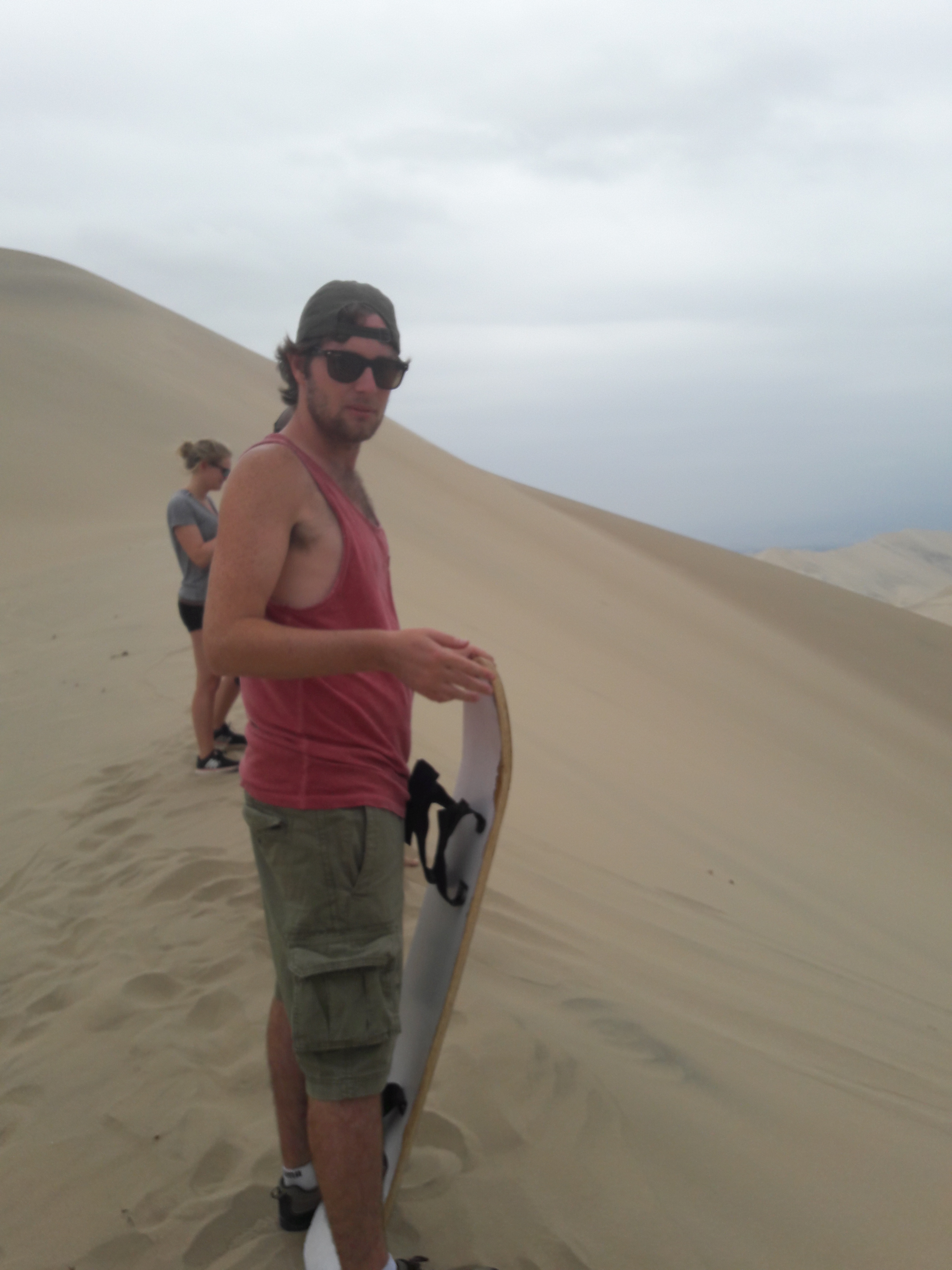 A man Sand boarding in Huacachina