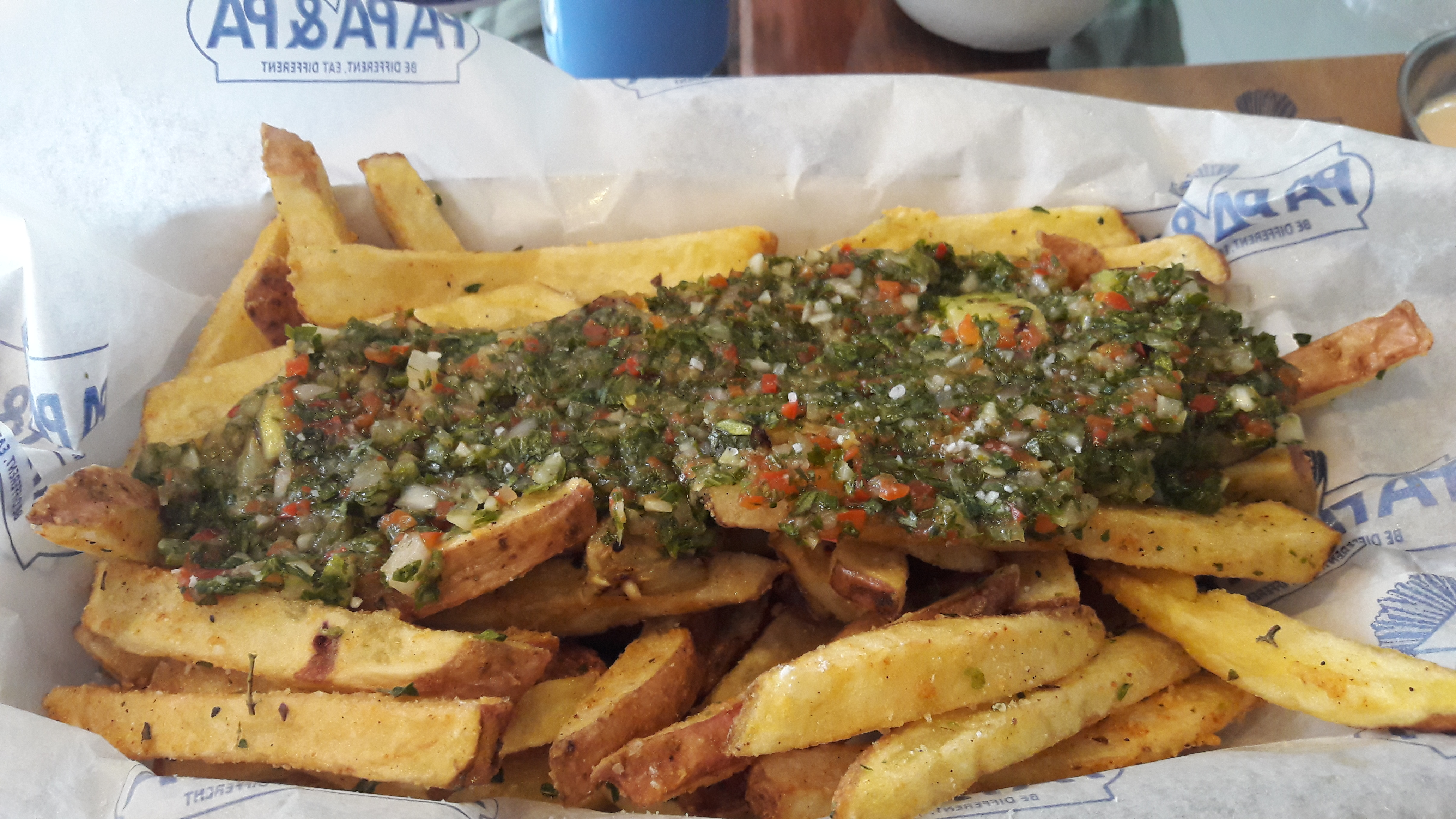 French fires with a topping of chimichurri sauce
