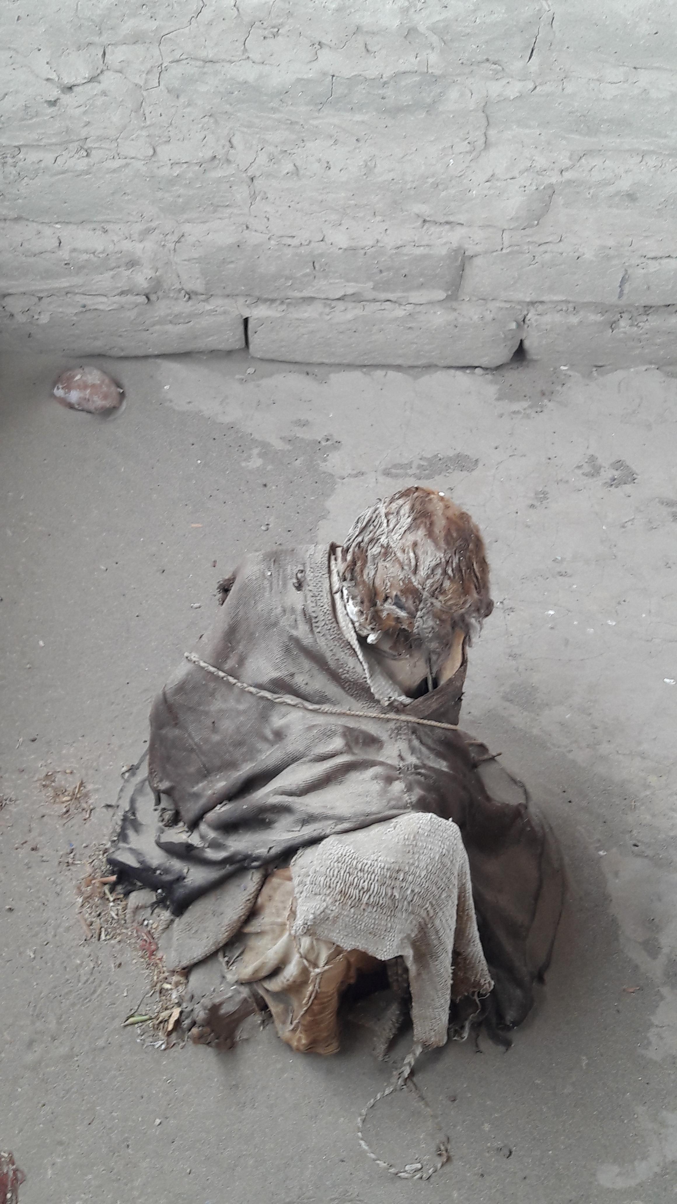 A mummified body on the ground