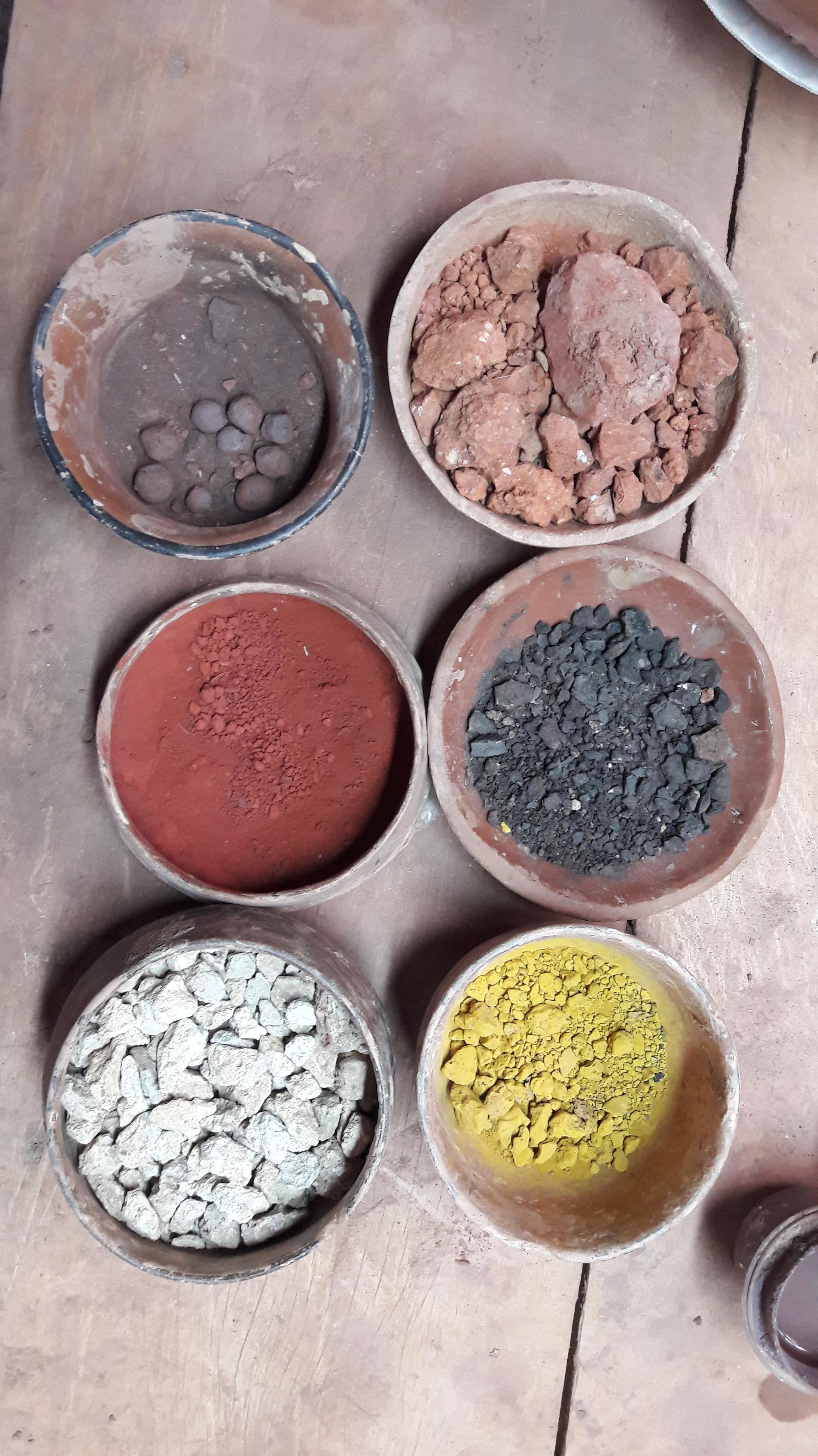 six pots full of colourful powders