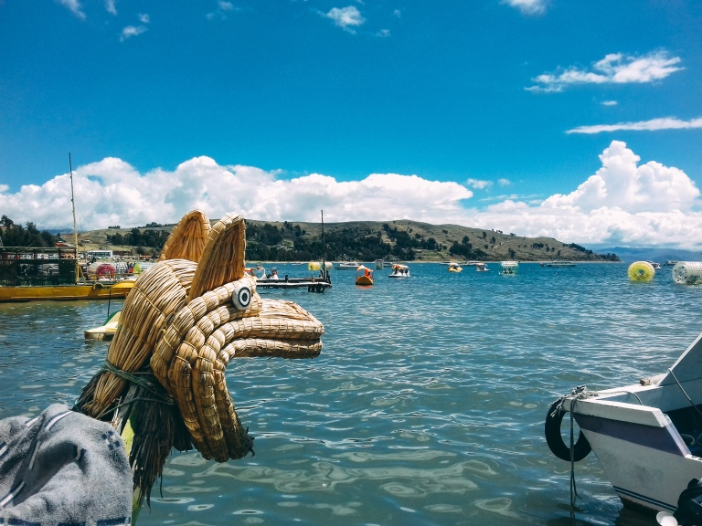 A typical Bolivian boat on a lake