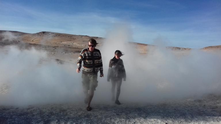 Two people walking through smock