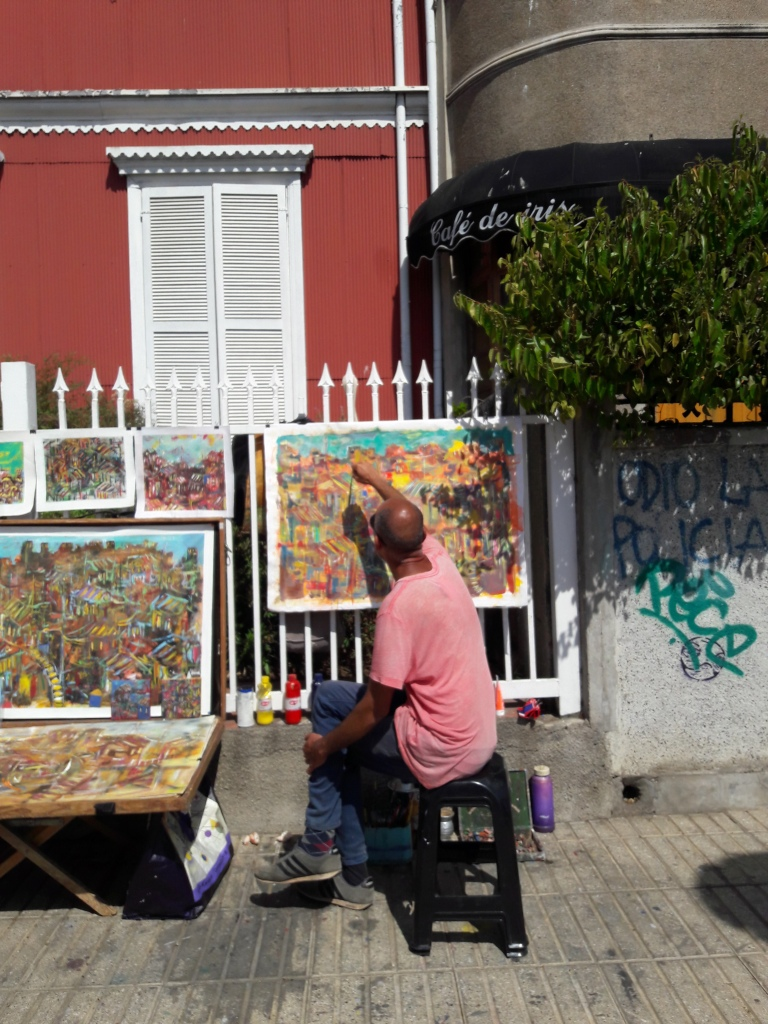 A man painting in the street